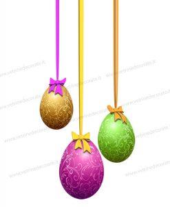 tre uova di pasqua con nastri e fiocchi
