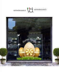 Vetrina-con-uova di pasqua con nastro e fiocco dorato