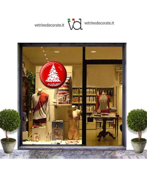 Vetrina con bottone rosso 3D con albero di natale e scritta auguri