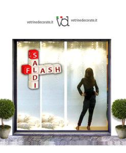Vetrina-con-scritta-saldi-flash
