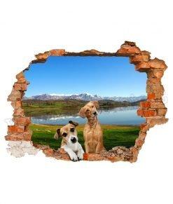 adesivo murale con un cucciolo e un cane adulto dietro al buco nella parete