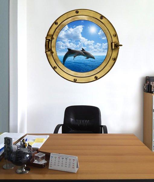 oblò con immagine di delfini che saltano