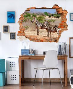 due zebre dietro ad un buco nel muro